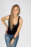 Menina flertando nas calças de brim Fotos de Stock Royalty Free