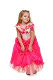 Menina flertando no vestido cor-de-rosa fotos de stock
