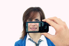 Menina fotografada pelo telemóvel Imagens de Stock