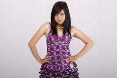 Menina fria de Ásia da expressão Fotografia de Stock