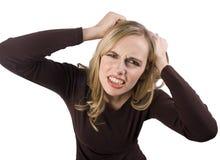 Menina frustrante que puxa o cabelo imagem de stock