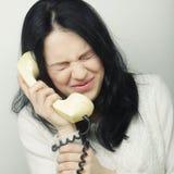 Menina furioso com telefone do vintage Imagens de Stock Royalty Free
