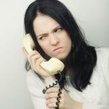 Menina furioso com telefone do vintage Imagem de Stock