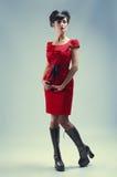 Menina gótico no vestido vermelho imagens de stock royalty free