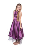 Menina Giggling no vestido violeta Fotos de Stock Royalty Free