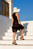 Menina glamoroso em escadas Imagem de Stock Royalty Free