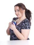 Menina gorda bebendo com o copo azul grande Fotos de Stock Royalty Free