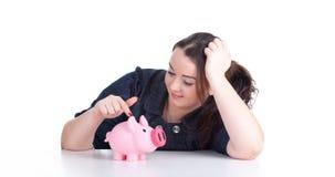 Menina gorda com o banco piggy cor-de-rosa Imagem de Stock Royalty Free