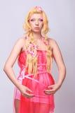 A menina gosta de uma boneca Foto de Stock Royalty Free
