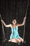 Menina gritando no assento do vestido no balanço Imagem de Stock Royalty Free