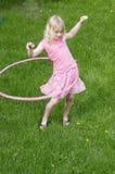 Menina Hula Hooping Imagem de Stock