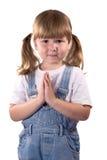 Menina impressionante que praying para? Imagem de Stock