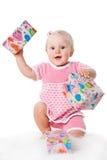 Menina infantil feliz com as caixas de presente no branco Imagens de Stock Royalty Free