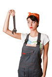 Menina Irresolute com chave inglesa Fotografia de Stock