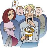 Menina irritada com o indivíduo no teatro de filme Imagens de Stock Royalty Free