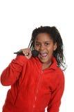 Menina jamaicana nova com microfone Foto de Stock Royalty Free