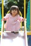 Menina japonesa na corrediça Imagens de Stock