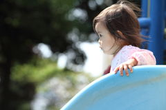 Menina japonesa na corrediça Imagens de Stock Royalty Free
