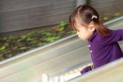 Menina japonesa na corrediça Foto de Stock Royalty Free