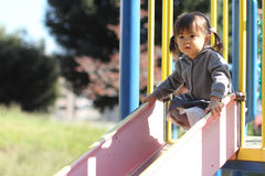 Menina japonesa na corrediça Fotos de Stock