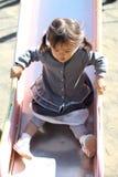 Menina japonesa na corrediça Fotos de Stock Royalty Free