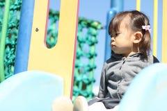 Menina japonesa na corrediça Imagem de Stock Royalty Free