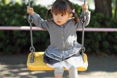 Menina japonesa na corrediça Imagem de Stock