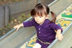 Menina japonesa na corrediça Fotografia de Stock