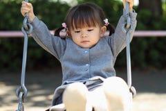 Menina japonesa no balanço Imagens de Stock Royalty Free