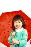 Menina japonesa pequena com um guarda-chuva Imagens de Stock Royalty Free