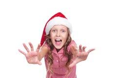 Menina jovial no chapéu de Papai Noel imagens de stock