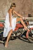 Menina latino-americano com moto Fotografia de Stock