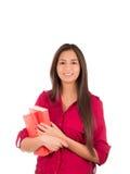 Menina latino nova que guarda livros Imagem de Stock Royalty Free
