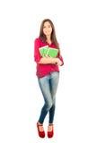Menina latino nova que guarda livros Imagem de Stock