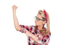 Menina loura bonito que olha seu braço forte Foto de Stock Royalty Free