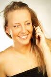 Menina loura com telefone de pilha Fotos de Stock