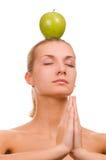 Menina loura com uma maçã verde Fotos de Stock
