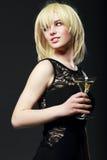 Menina loura com vidro de martini Fotos de Stock