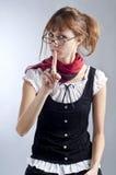 Menina loura com vidros, pena e livro Imagem de Stock