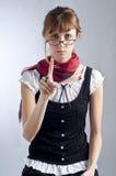Menina loura com vidros, pena e livro Imagens de Stock