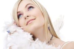 Menina loura feliz do anjo com boa de pena Imagem de Stock