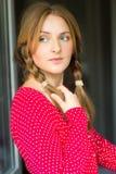 Menina loura feminino inocente com tranças Foto de Stock Royalty Free