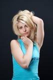 Menina loura no azul 02 Imagens de Stock Royalty Free
