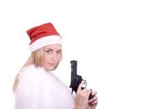 Menina loura no chapéu de Santa com injetor Foto de Stock Royalty Free