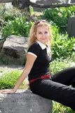 Menina loura no jardim Foto de Stock Royalty Free