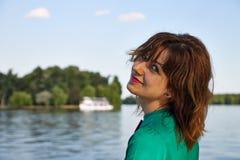 Menina loura no lago Imagens de Stock