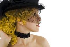 Menina loura no tampão com véu Foto de Stock Royalty Free