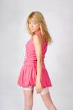 Menina loura nova bonita na cor-de-rosa Imagens de Stock