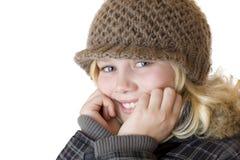 Menina loura nova com tampão e revestimento do inverno Imagem de Stock Royalty Free