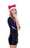 Menina loura pensativa com chapéu de Christamas Foto de Stock Royalty Free